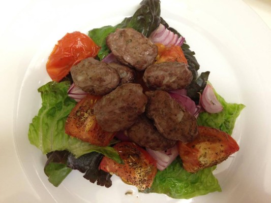 Mini beef koftas served on a bed of lettuce